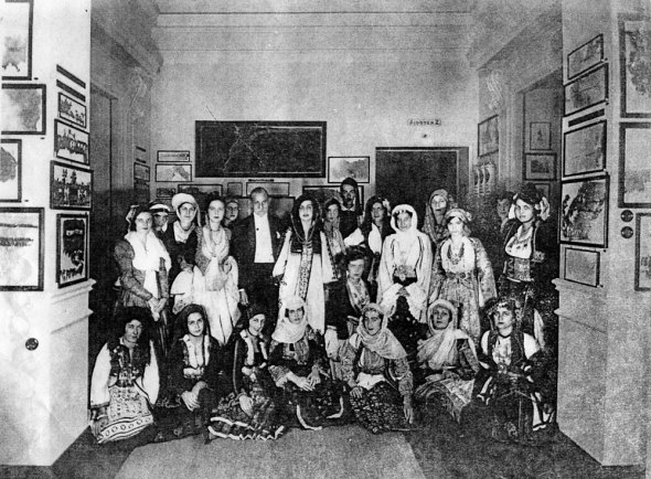 Antonis Benakis with a circle of women in traditional dress in the Benaki Museum, probably from the 1930s.  Benaki Museum.