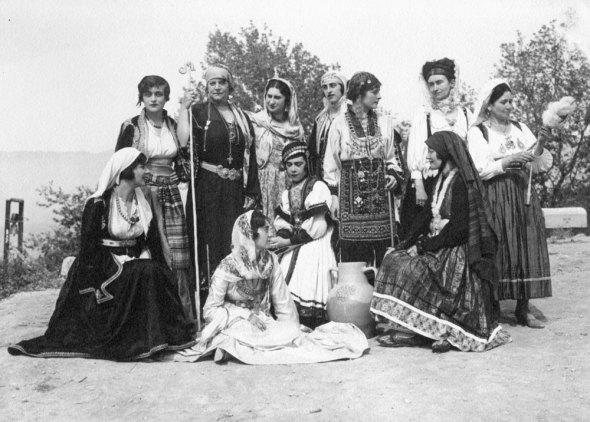 Group portrait of women in traditional attire, Delphic Celebrations 1930. Photo by Nelly's. Top row, third from left, Mrs. Virginia Romanos, née Benaki, and bottom row, second seated from left, Ms. Argiro Paparrigopoulou. Alexandros Romanos Archive.