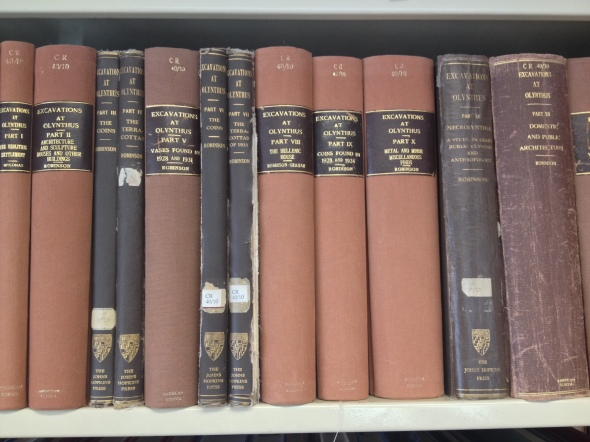 The Olynthus volumes on the shelf of the Blegen Library in the ASCSA
