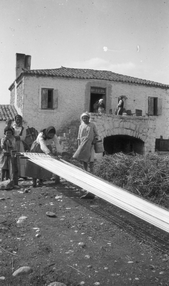 The dig house at Parapoungia for the Eutresis excavation. Dorothy Burr capturing her local friends weaving. ASCSA Archives, Dorothy Burr Thompson Photographic Collection.