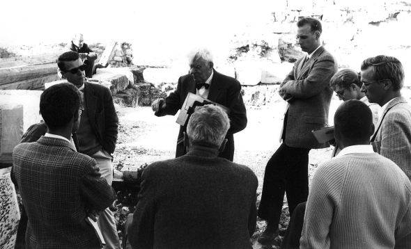 William Bell Dinsmoor lecturing on the Acropolis. Yound T. Leslie Shear to the right of Dinsmoor, and William (Bill) Wyatt to the left of Dinsmoor. Ione Mylonas to the right of Shear. Photo: Patricia Lawrence, 1959-1960.